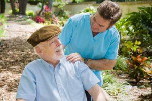 male carer attending elderly resident