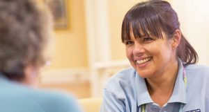 smiling care worker in a care home
