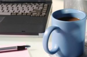 keyboard and coffee mug denoting office work