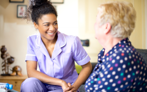 smiling female carer with a resident